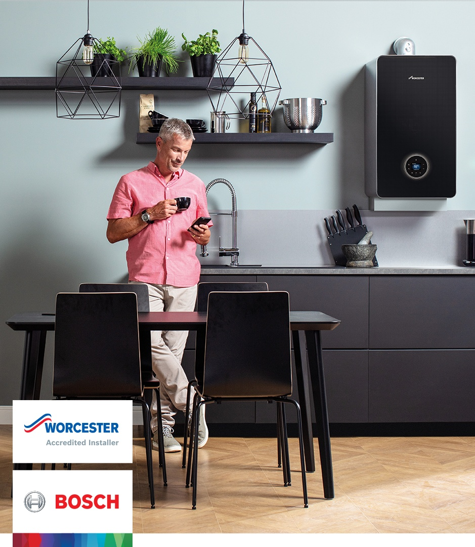 Worcester Bosch advert man in kitchen on phone